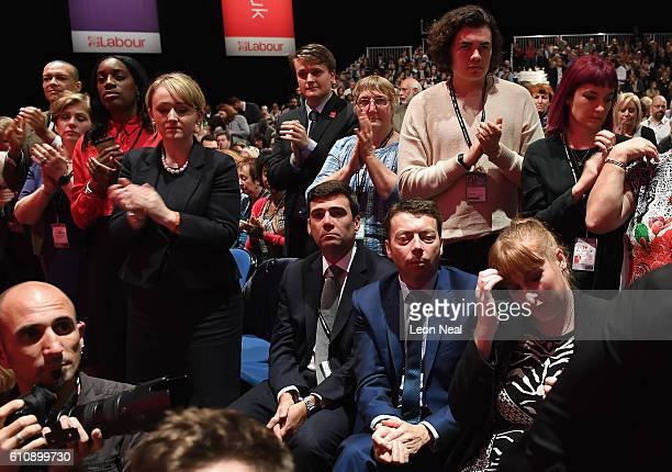 Andy Burnham and Iain McNicol remain seated as Labour party leader Jeremy Corbyn repeated his apology for the Iraq War during his keynote speech at...