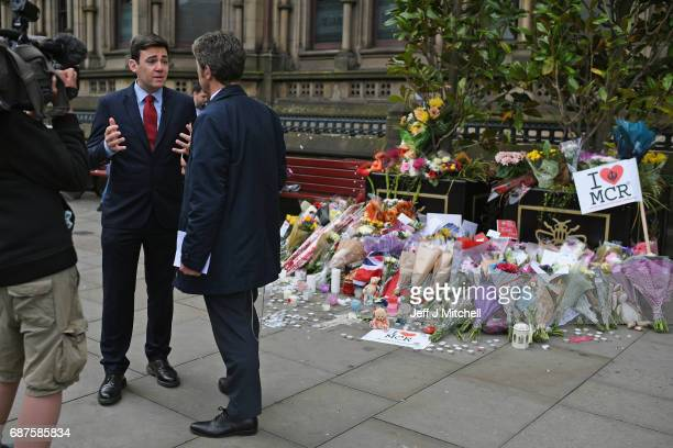 Andy Burnham Mayor of Greater Manchester gives an interview next to floral tributes and messages as the working day begins on May 24 2017 in...