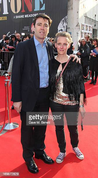 Andy Burnham MP and wife MarieFrance van Heel attend the world premiere of 'Stone Roses Made Of Stone' at Victoria Warehouse on May 30 2013 in...