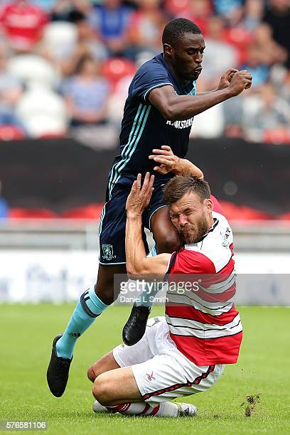 Andy Butler of Doncaster Rovers FC collides with Mustapha Carayol of Middlesbrough FC during the preseason friendly match between Doncaster Rovers...