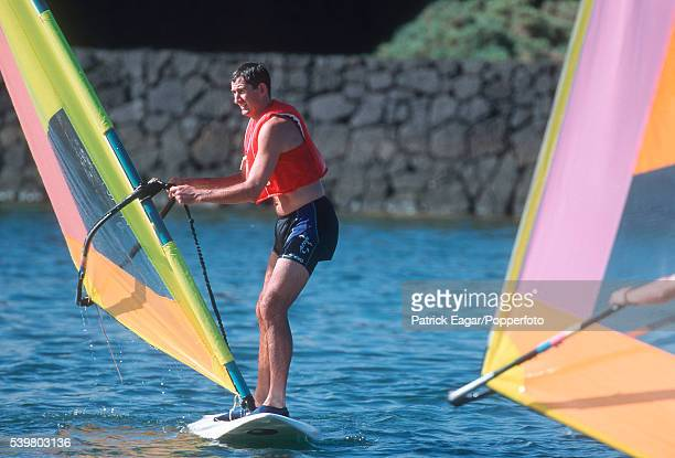 Andy Caddick of England tries windsurfing during the England training tour in Lanzarote November 1997