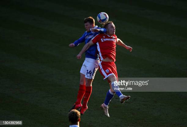 Andy Cannon of Portsmouth FC and Kyle Dempsey of Gillingham FC jump for the ball during the Sky Bet League One match between Portsmouth and...