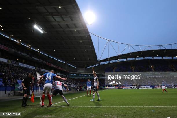 Andy Cannon of Portsmouth FC battles for possession with Brandon Fleming of Bolton Wanderers during the Sky Bet League 1 match between Bolton...