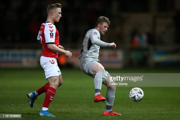 Andy Cannon of Portsmouth FC battles for possession with Kyle Dempsey of Fleetwood Town during the FA Cup Third Round match between Fleetwood Town...