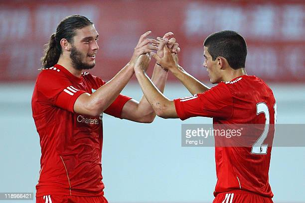 Andy Carroll and Conor Coady of Liverpool celebrates scoring a goal during the preseason friendly match between Guangdong Sunray Cave and Liverpool...