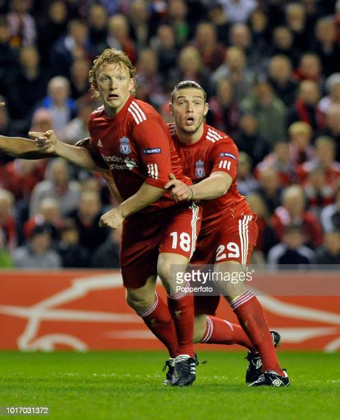 Andy Carroll and Dirk Kuyt of Liverpool in action during the UEFA Europa League Round of 16 second leg match between Liverpool and SC Braga at...