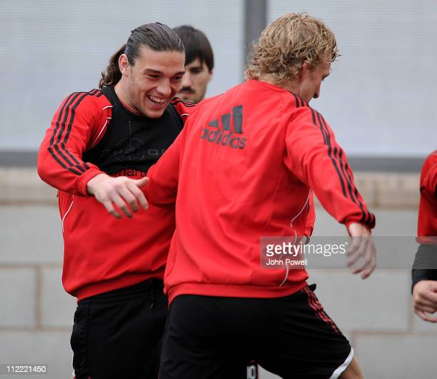Andy Carroll and Dirk Kuyt of Liverpool warm up during a training session at Melwood Training Ground on April 15 2011 in Liverpool England