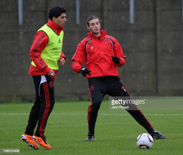Andy Carroll and Luis Suarez of Liverpool during a training session at Melwood Training Ground on February 21 2011 in Liverpool England