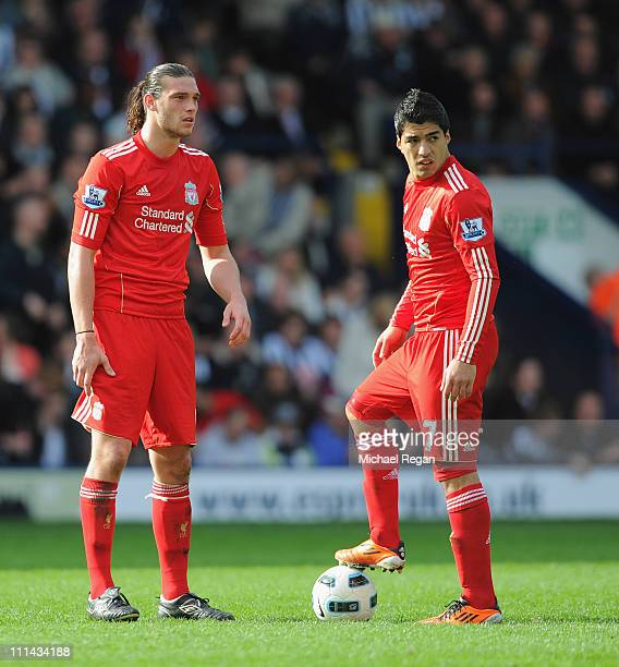 Andy Carroll and Luis Suarez of Liverpool look dejected after the first West Brom goal during the Barclays Premier League match between West Bromwich...