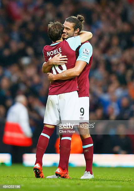 Andy Carroll and Mark Noble of West Ham United celebrate their 21 win in the Barclays Premier League match between West Ham United and Chelsea at...