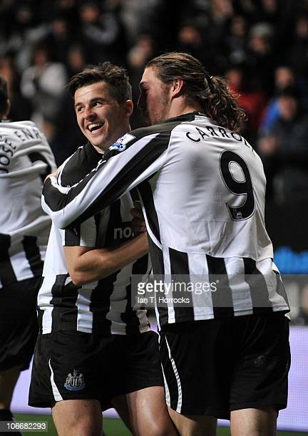 Andy Carroll celebrates with Joey Barton after scoring the second goal and equalizing for Newcastle during the Barclays Premier League match between...
