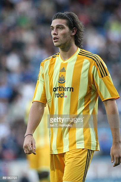 Andy Carroll in action during a preseason friendly match between Huddersfield Town and Newcastle United at the Galpharm Stadium on July 21 2009 in...