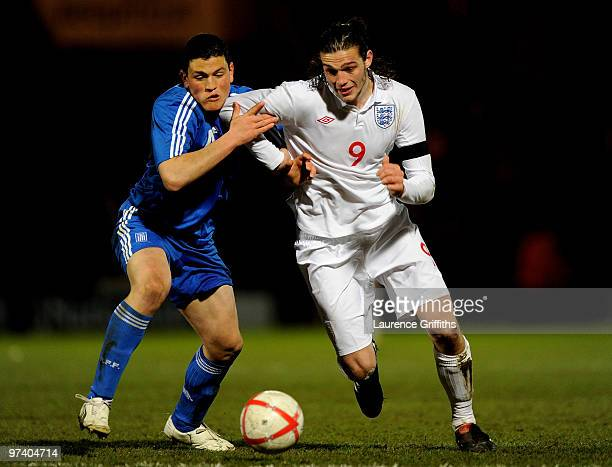 Andy Carroll of England battles for the ball with Kyriakos Papadopoulos of Greece during the UEFA Under 21 Championship Qualifying match between...
