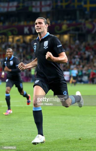 Andy Carroll of England celebrates the first goal during the UEFA EURO 2012 group D match between Sweden and England at The Olympic Stadium on June...