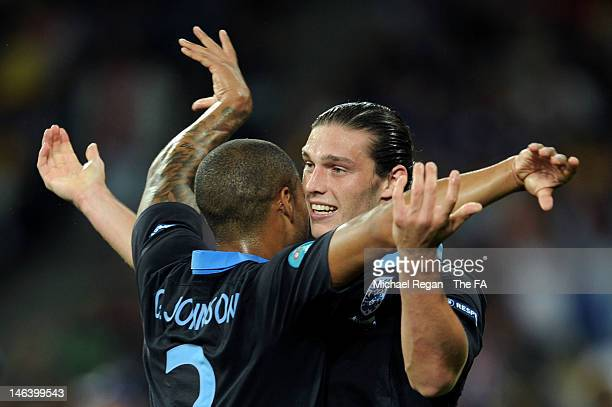 Andy Carroll of England celebrates the first goal with Glen Johnson of England during the UEFA EURO 2012 group D match between Sweden and England at...