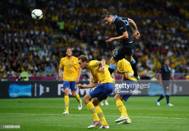 Andy Carroll of England heads the first goal during the UEFA EURO 2012 group D match between Sweden and England at The Olympic Stadium on June 15...