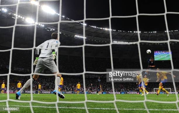 Andy Carroll of England heads the first goal past Andreas Isaksson of Sweden during the UEFA EURO 2012 group D match between Sweden and England at...