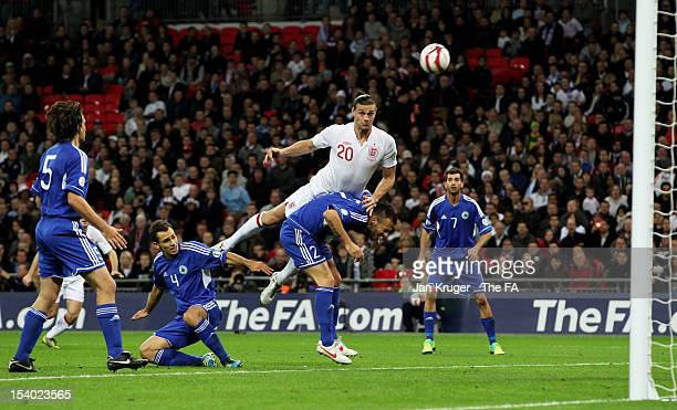 Andy Carroll of England heads towards goal as he challenges Fabio Vitaioli of San Marino during the FIFA 2014 World Cup Group H qualifying match...