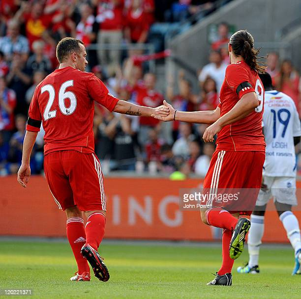 Andy Carroll of Liverpool celebrates after scoring the opening goal during the preseason friendly between Valerengra and Liverpool at the Ullevaal...