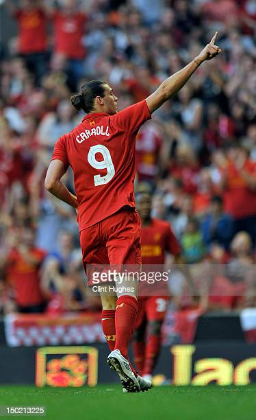 Andy Carroll of Liverpool celebrates after scoring the third goal of the game for his side during the pre season friendly match between Liverpool and...