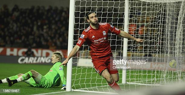 Andy Carroll of Liverpool celebrates his goal during the Barclays Premier League match between Wolverhampton Wanderers and Liverpool at Molineux on...