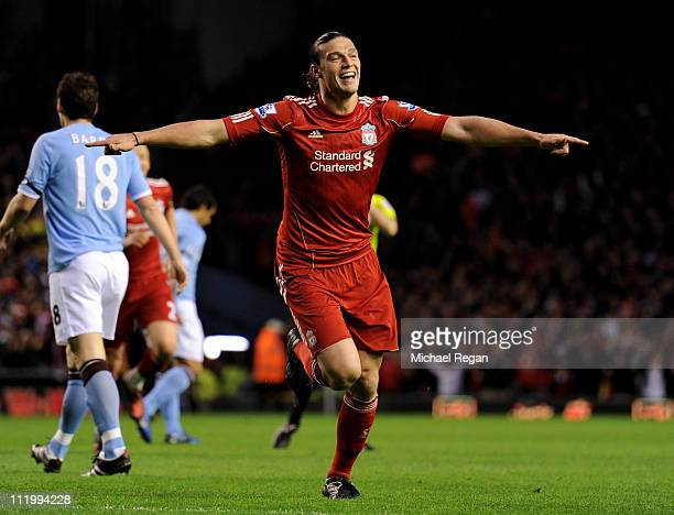 Andy Carroll of Liverpool celebrates scoring the opening goal during the Barclays Premier League match between Liverpool and Manchester City at...
