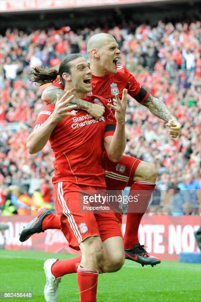 Andy Carroll of Liverpool celebrates scoring the winning goal with teammate Martin Skrtel during the FA Cup Semi Final match between Liverpool and...