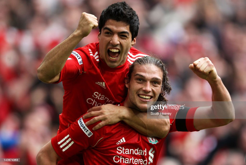 Andy Carroll of Liverpool celebrates with Luis Suarez as he scores their second goal during the FA Cup with Budweiser Semi Final match between Liverpool and Everton at Wembley Stadium on April 14, 2012 in London, England.