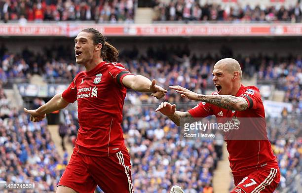 Andy Carroll of Liverpool celebrates with Martin Skrtel as he scores their second goal during the FA Cup with Budweiser Semi Final match between...