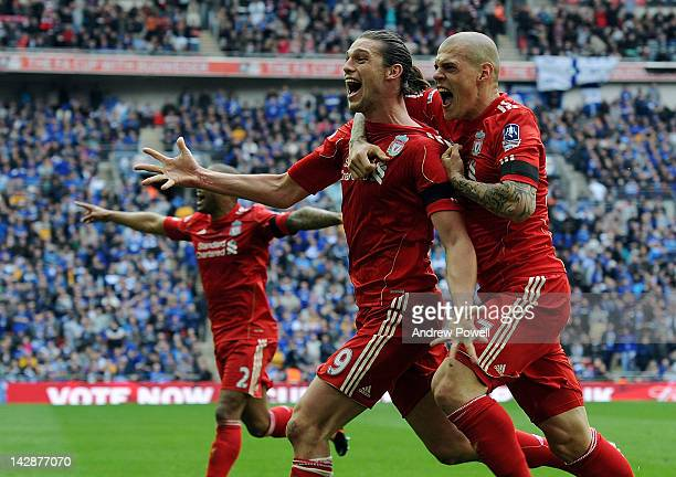 Andy Carroll of Liverpool celebrates with teammates Martin Skrtel and Glen Johnson after scoring the winning goal during the FA Cup semifinal...