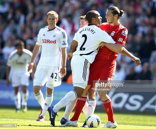 Andy Carroll of Liverpool clashes with Ashley Williams of Swansea City during the Barclays Premier League match between Swansea City and Liverpool at...