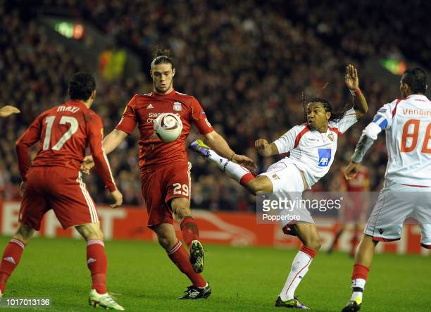 Andy Carroll of Liverpool competes with Alan of Braga during the UEFA Europa League Round of 16 second leg match between Liverpool and SC Braga at...