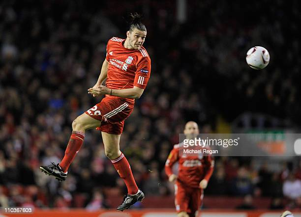 Andy Carroll of Liverpool heads the ball during the UEFA Europa League Round of 16 second leg match between Liverpool and SC Braga at Anfield on...