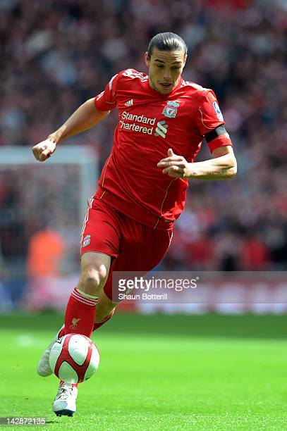 Andy Carroll of Liverpool runs with the ball during the FA Cup with Budweiser Semi Final match between Liverpool and Everton at Wembley Stadium on...