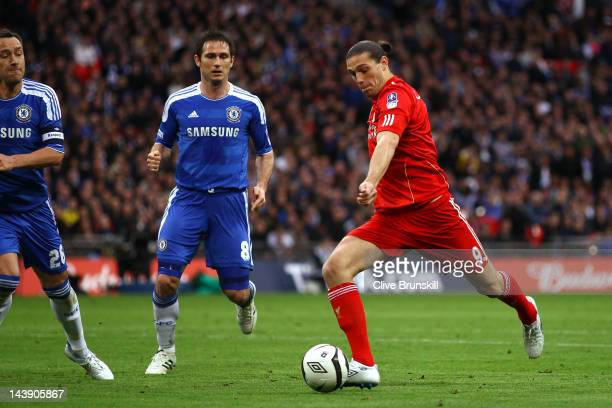 Andy Carroll of Liverpool scores their first goal during the FA Cup with Budweiser Final match between Liverpool and Chelsea at Wembley Stadium on...