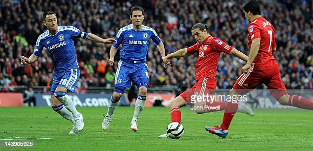 Andy Carroll of Liverpool scores their first goal during the FA Cup Final match between Chelsea and Liverpool at Wembley Stadium on May 5 2012 in...