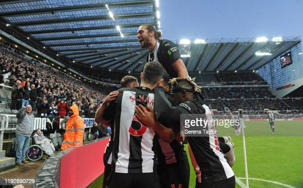 Andy Carroll of Newcastle United celebrates Federico Fernandez of Newcastle United winning goal during the Premier League match between Newcastle...