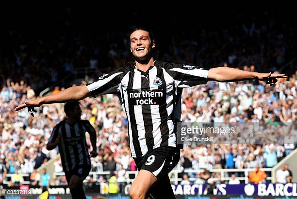 Andy Carroll of Newcastle United celebrates scoring his teams fourth goal during the Barclays Premier League match between Newcastle United and Aston...