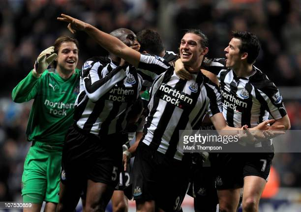 Andy Carroll of Newcastle United celebrates scoring his team's third goal with his team mates during the Barclays Premier League match between...