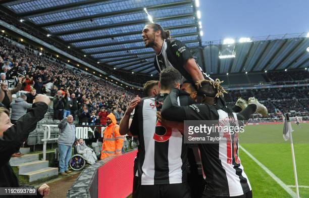 Andy Carroll of Newcastle United celebrates with teammates Federico Fernandez of Newcastle United winning goal during the Premier League match...