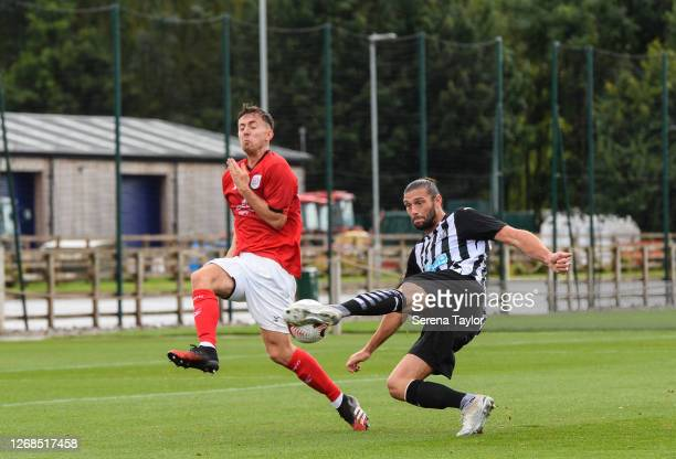 Andy Carroll of Newcastle United FC controls the ball and scores Newcastle's opening goal during the Pre Season Friendly match between Newcastle...