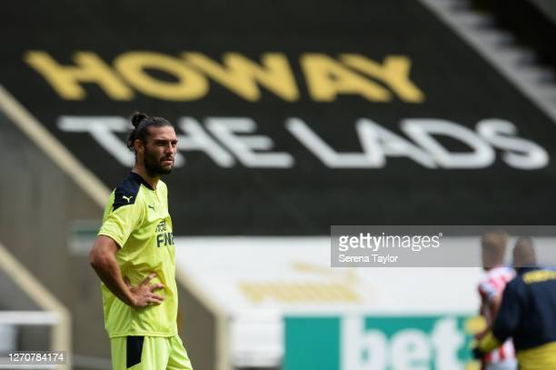 Andy Carroll of Newcastle United FC stands in front of Howay the lads banner during the Pre Season Friendly between Newcastle United and Stoke City...