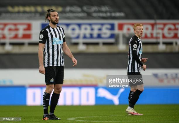 Andy Carroll of Newcastle United FC stands in the circle after he scores his first goal during the Premier League match between Newcastle United and...