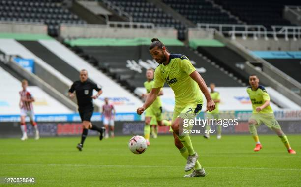 Andy Carroll of Newcastle United FC strikes the ball during the Pre Season Friendly between Newcastle United and Stoke City at St James' Park on...