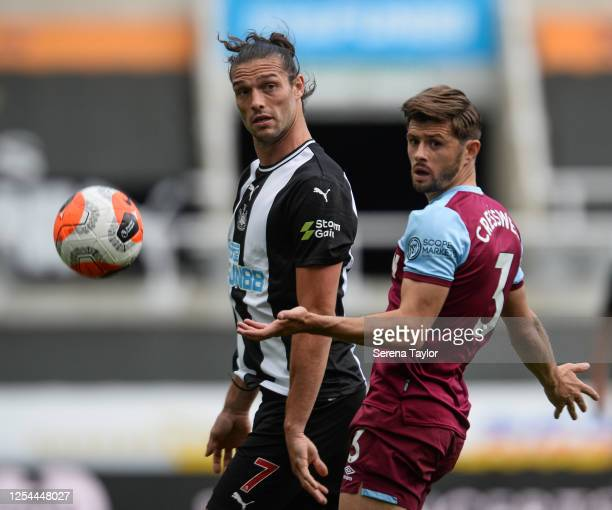 Andy Carroll of Newcastle United FC wins a header over Aaron Cresswell of West Ham United during the Premier League match between Newcastle United...