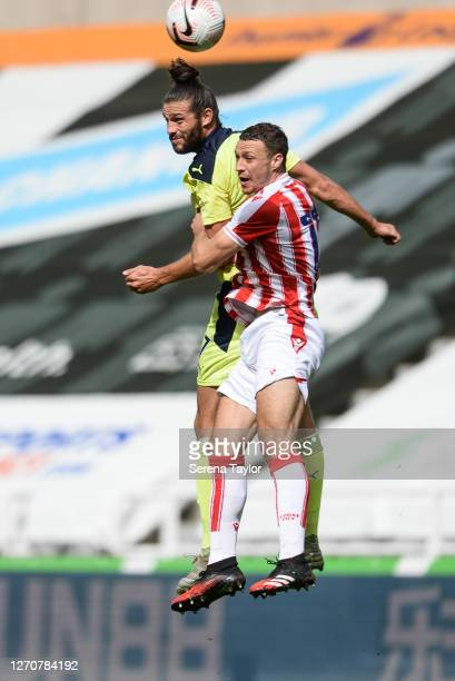 Andy Carroll of Newcastle United FC wins a header over James Chester of Stoke City during the Pre Season Friendly between Newcastle United and Stoke...