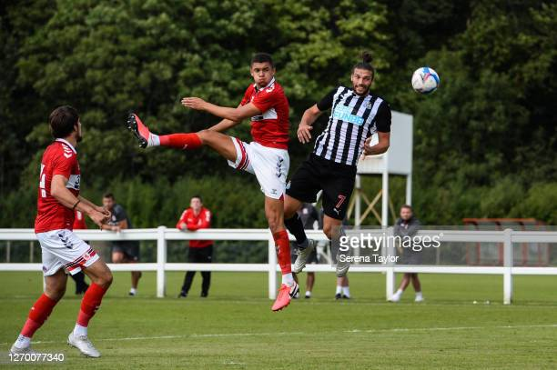 Andy Carroll of Newcastle United FC wins a header over Nathan Wood of Middlesbrough FC during the Pre Season Friendly between Newcastle United and...