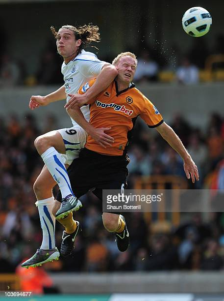 Andy Carroll of Newcastle United outjumps Jody Craddock of Wolverhampton Wanderers during the Barclays Premier League match between Wolverhampton...