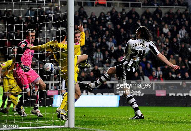 Andy Carroll of Newcastle United scores a goal during the Coca Cola Championship game between Newcastle United and Cardiff City at St James' Park on...