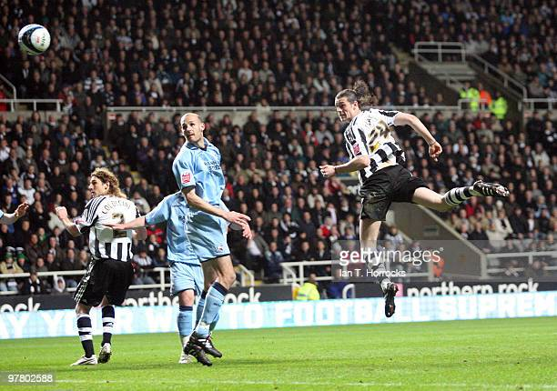Andy Carroll of Newcastle United scores his opening goal during the Coca Cola Championship match between Newcastle United and Scunthorpe United at St...